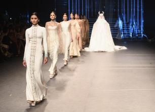DUBAI, UNITED ARAB EMIRATES - OCTOBER 21: Models walk the runway at the Ezra show during Fashion Forward Spring/Summer 2017 at the Dubai Design District on October 21, 2016 in Dubai, United Arab Emirates. (Photo by Stuart C. Wilson/Getty Images)